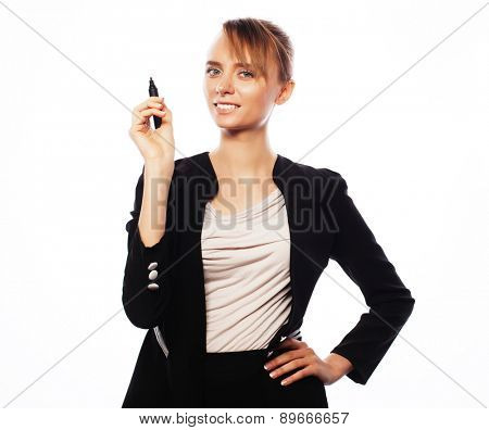 Business, finance and people concept: young business woman writing something in the air with marker