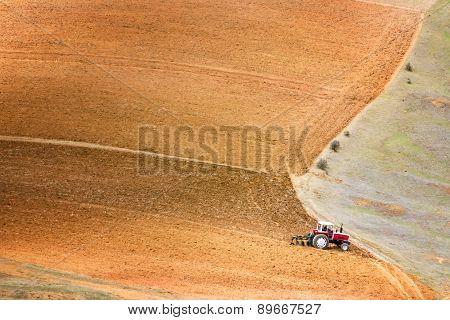 Tractor Plowing A Field