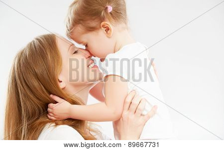 Happy Family Mother And  Baby Daughter Hugging And Kissing