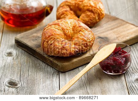 Fresh Croissants On Wooden Server Board Ready To Eat