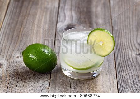 Ice Cold Lime Drink On Rustic Wood