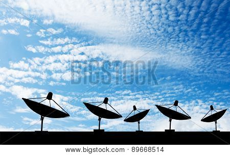 Satellite dish on the roof silhouette.blue sky background