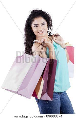 Joyful Indian Woman Carrying Shopping Bags