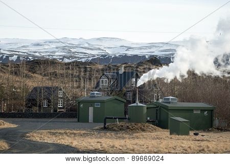 ICELAND - MARCH 25, 2015: A farm utilizes geothermal energy to generate electricity for domestic use. Non-polluting steam is released as a by-product and is environmental friendly.