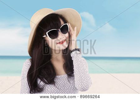 Lovely Female Model With Hat At Coast