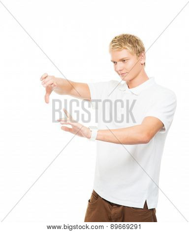 Young and handsome teenage boy working with an imaginary and invisible touchscreen isolated on white