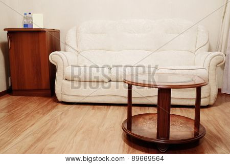 Beige sofa and coffee table
