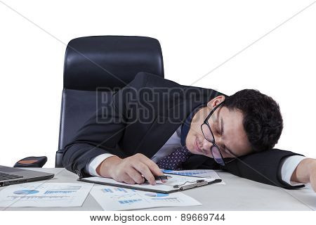 Male Worker Sleeping With Documents On Table