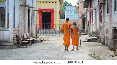 Buddhist Monks At An Ancient Khmer Temple