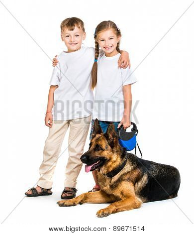 happy children with a shepherd dog on a white background isolated