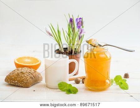 breakfast of milk and donuts on a white wooden table