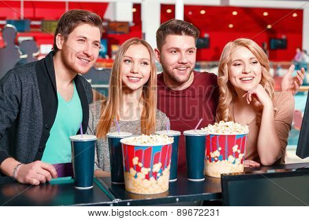 Group of people buying popcorn and coke
