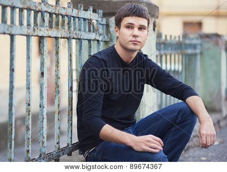 Portrait of young attractive man on a vintage background