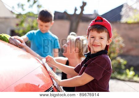 Happy Little Kid Car Wash With Family