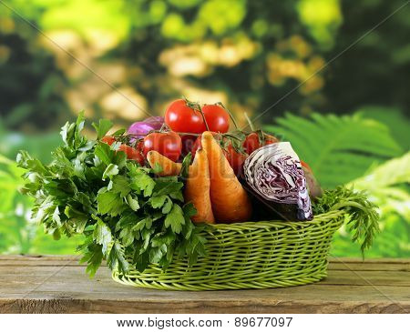 various vegetables (carrots, potatoes, cabbage, tomatoes) in basket