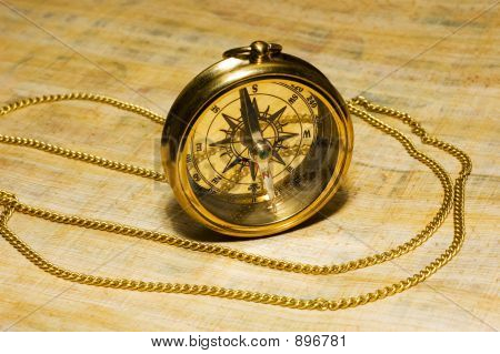 Old Style Gold Compass On Papyrus Background