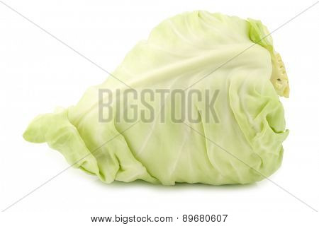 a fresh harvested green pointed cabbage on a white background