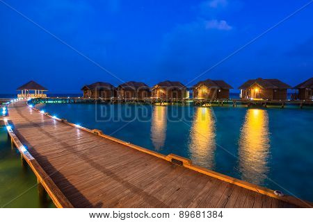 Over water bungalows with steps into amazing green lagoon