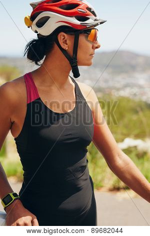 Female Cyclist Looking Away
