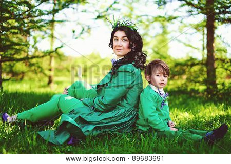 Toned image of young mother and her son spending time outdoor