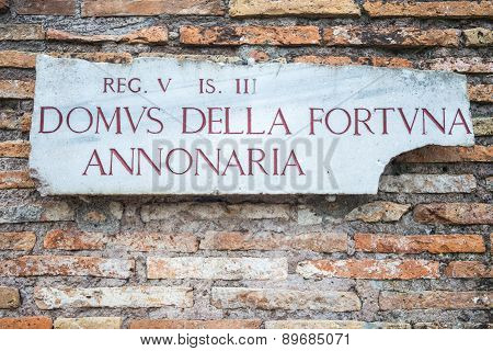 Ancient Roman Signpost In Rome, Italy