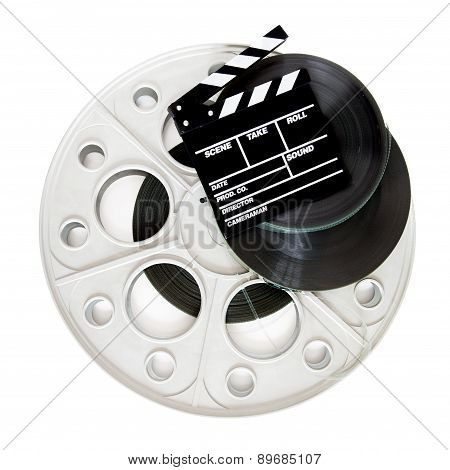 Movie Clapper On 35 Mm Cinema Film Reels Isolated