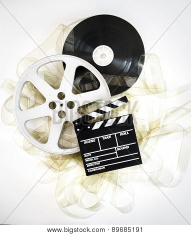 Movie Clapper On 35 Mm Cinema Reels With Unrolled Filmstrip