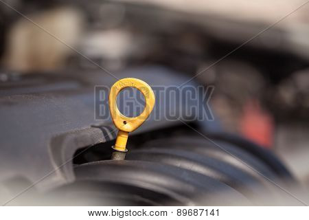 Yellow oil dipstick in the car