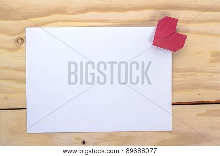 origami heart and white paper sheet for love letter.