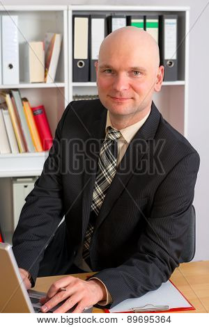 Young Businessman With Bald Head In The Office