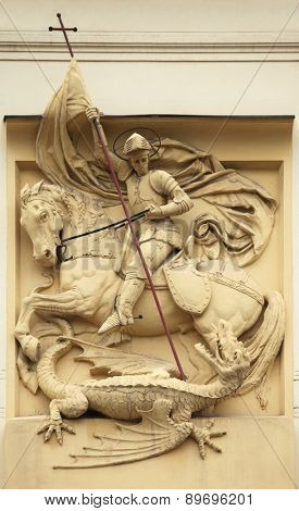Saint George killing the Dragon. Stucco decoration on the Art Nouveau building in Prague, Czech Republic.