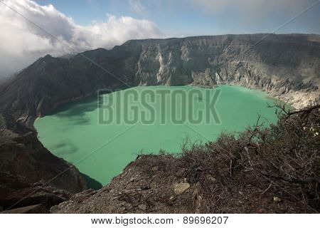 Acid lake in the crater of the active volcano of Kawah Ijen, East Java, Indonesia.