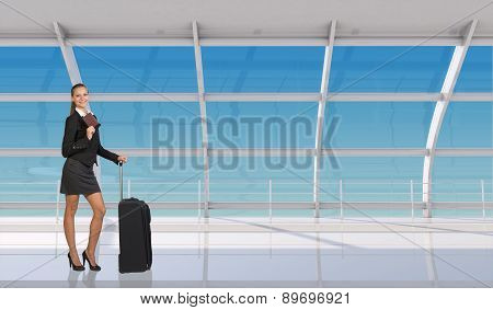 Flight attendant holding passport in airport