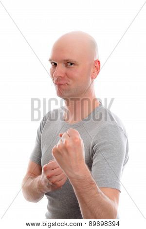 Funny Young Man With Bald Head And Fist- Hands