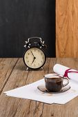 pic of private investigator  - Old clock hat coffee and paper sheets on old Wooden table - JPG