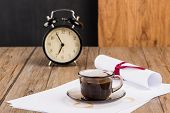 foto of private investigator  - Old clock hat coffee and paper sheets on old Wooden table - JPG