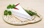 image of brie cheese  - Soft brie cheese with rosemary thyme on the wood background - JPG
