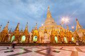 picture of yangon  - Shwedagon Pagoda Temple shining in the beautiful sunset in Yangon Myanmar - JPG