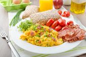 stock photo of scrambled eggs  - Scrambled eggs with bacon chive and tomatoes fresh juice and little microgreens healthy salad - JPG
