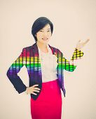 stock photo of polite girl  - Pretty Asian reporter is posing a presentation gesture in white background with colorful abstract light effect on her body - JPG