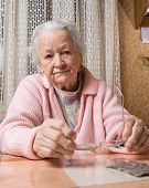 image of saddening  - Portrait of old sad woman at home - JPG
