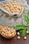 picture of chickpea  - Chickpeas in a burlap bag on a wooden background - JPG
