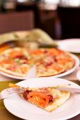 stock photo of tourist-spot  - Authentic pizza with tomatoes smoked sausage bacon and parsley. Morning atmospheric lighting fashionable trendy spot soft focus. Preparation for design creative menu. ** Note: Visible grain at 100%, best at smaller sizes - JPG
