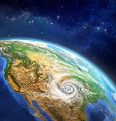foto of outer  - Very high definition picture of planet earth in outer space with a cyclone on USA soil - JPG