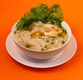 picture of glass noodles  - Glass noodle soup with chicken and beansprouts on an orange background - JPG