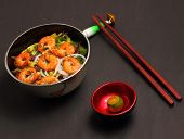 picture of rice noodles  - Vietnamese shrimp and rice noodles soup pho on a black background - JPG