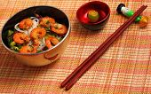 pic of rice noodles  - Vietnamese shrimp and rice noodles soup pho served on a bamboo place mat - JPG