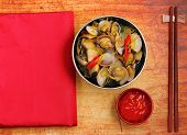 foto of clam  - herbal clam soup Vietnam style served on a wood table top - JPG