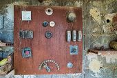 foto of levers  - Vintage electrical switchboard with multiple controls fuses and levers - JPG