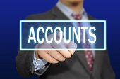 stock photo of accountability  - Business concept image of a businessman clicking Accounts button on virtual screen over blue background - JPG